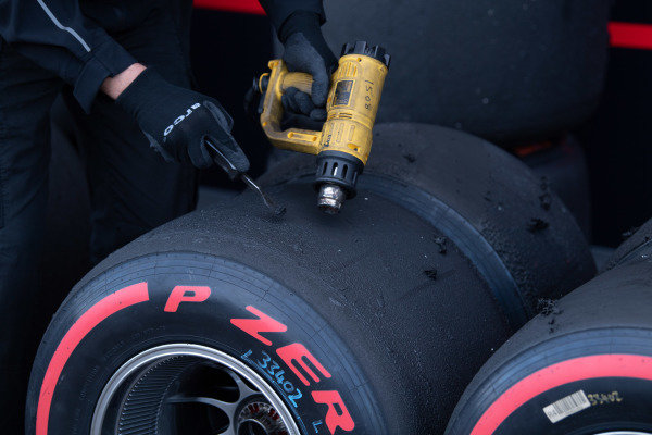 Technicians work on some tyres