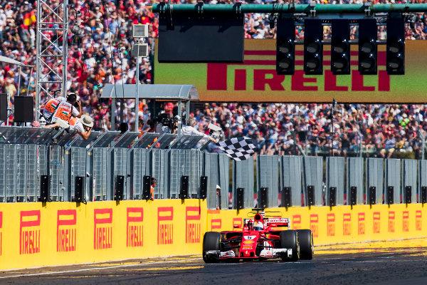 Hungaroring, Budapest, Hungary. Sunday 30 July 2017. Sebastian Vettel, Ferrari SF70H, 1st Position, takes the chequered flag. World Copyright: Zak Mauger/LAT Images ref: Digital Image _56I6666