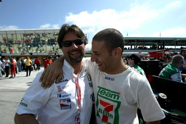 Andretti Green team owner Michael Andretti (USA), left, and Tony Kanaan (BRA), enjoy a laugh before qualifying for the Toyota Indy 300.IRL IndyCar Series, Rd1, Toyota Indy 300, Homestead-Miami Speedway, Florida, USA. 29 February 2004.DIGITAL IMAGE