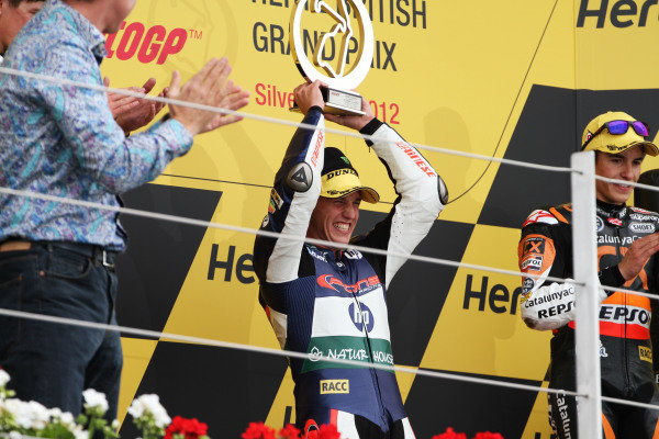 British Grand Prix.  Silverstone, England. 15th-17th June 2012.  Moto2. Pol Espargaro, Pons Kalex, celebrates victory on the podium.  World Copyright: Kevin Wood/LAT Photographic.  ref: Digital Image IMG_7836a