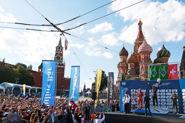 2014/2015 FIA Formula E Championship.  Moscow e-Prix, Moscow, Russia. Saturday 6 June 2015. Nelson Piquet Jr (BRA)/China Racing - Spark-Renault SRT_01E, Lucas di Grassi (BRA)/Audi Abt Sport - Spark-Renault SRT_01E & Sebastien Buemi (SWI)/E.dams Renault - Spark-Renault SRT_01E on the podium Photo: Sam Bloxham/LAT/Formula E ref: Digital Image _SBL5933
