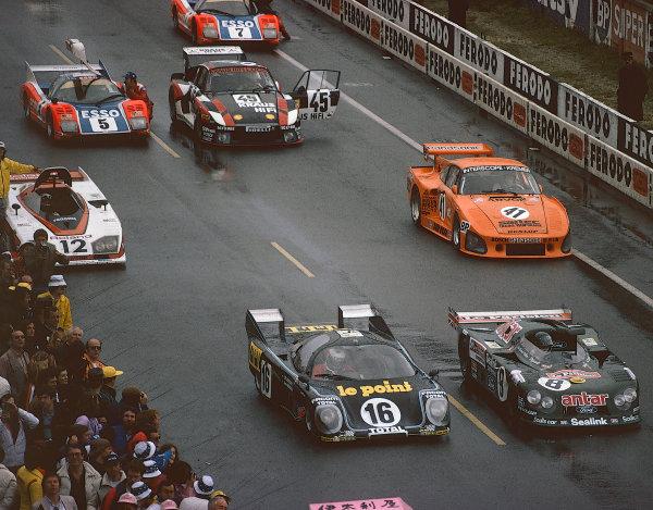 1980 Le Mans 24 Hours. Le Mans, France. 14th - 15th June 1980.Front Row: Jean Rondeau/Jean-Pierre Jaussaud (Rondeau M379B Ford), 1st position, Alain de Cadenet/Francois Migault (De Cadenet LM Ford), 7th position, Second Row: Chris Craft/Bob Evans (Dome RL80 Ford), 25th position, Ted Field/Danny Ongais/Jean-Louis Lafosse (Porsche 935 K3), retired, action. World Copyright: LAT Photographic. Ref: 80LM19.