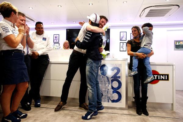Silverstone, Northamptonshire, England. Saturday 5 July 2014. Felipe Massa, Williams F1, celebrates his 200th Grand Prix start with his family and team. World Copyright: Glenn Dunbar/LAT Photographic. ref: Digital Image _89P2272