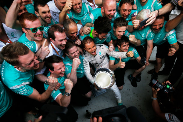 Shanghai International Circuit, Shanghai, China. Sunday 17 April 2016. Nico Rosberg, Mercedes AMG, 1st Position, and the Mercedes team celebrate with the winners trophy. World Copyright: Sam Bloxham/LAT Photographic ref: Digital Image _R6T1907