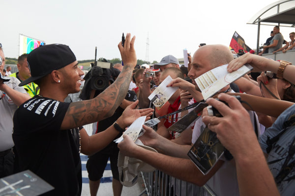 Hungaroring, Budapest, Hungary. Thursday 23 July 2015. Lewis Hamilton, Mercedes AMG, signs autographs for fans. World Copyright: Steve Etherington/LAT Photographic ref: Digital Image SNE11184