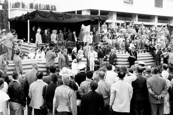 Monte Carlo, Monaco. 18 May 1958.Maurice Trintignant, Cooper T45-Climax, 1st position, receives the winning trophy from HRH Prince Rainier and Princess Grace, portrait, podium.World Copyright: LAT PhotographicRef: Autosport b&w print. Published: Autosport, 23/5/1958 p653