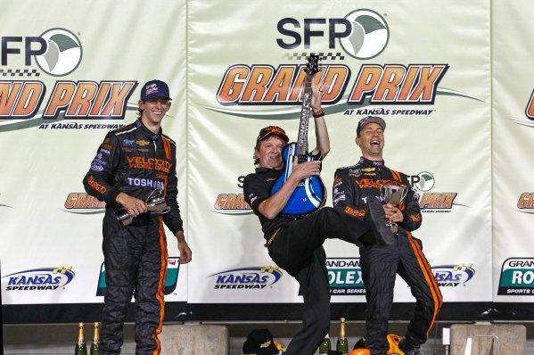 16-17 August, 2013, Kansas City, Kansas USA Wayne Taylor rocks the podium with drivers Jordan Taylor and Max Angelelli ©2013, Phillip Abbott LAT Photo USA22