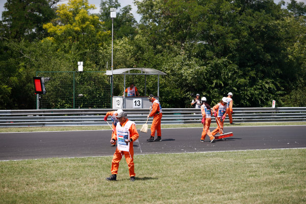 Hungaroring, Budapest, Hungary.  Friday 28 July 2017. FP1 was red-flagged after Jolyon Palmer, Renault Sport F1, ran wide and covered the track with debris. Marshals sweep the track clean. World Copyright: Glenn Dunbar/LAT Images  ref: Digital Image _31I8140