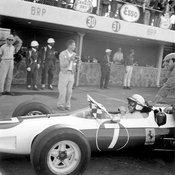 1964 Mexican Grand Prix.Mexico City, Mexico, 25 October 1964.John Surtees (Ferrari 158) becomes the only man to win World Championships on motorbikes and in a car. Ref-27508 40mb Scan from B&W Print.World Copyright: LAT Photographic