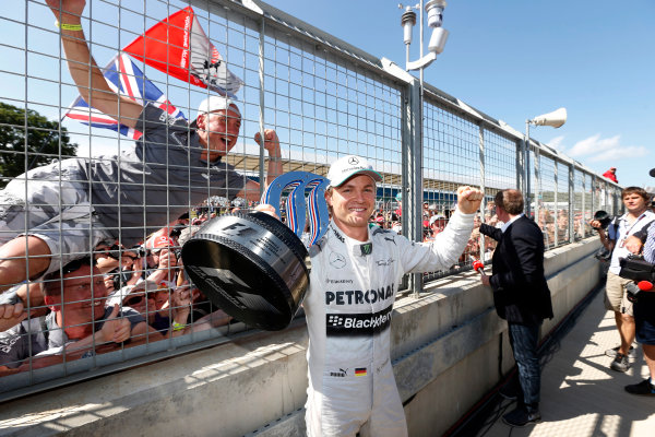 Silverstone, Northamptonshire, England. 30th June 2013. Nico Rosberg, Mercedes AMG, 1st position, shows his trophy to the crowd World Copyright: Charles Coates/  ref: Digital Image _N7T4914