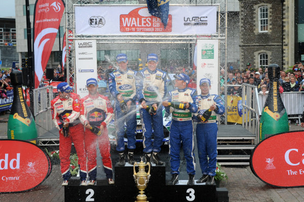 Podium (L to R): Second place finishers Sebastien Loeb (FRA) and Daniel Elena (MC), Citroen, rally winners Jari-Matti Latvala (FIN) and Miikka Anttila (FIN), Ford and third placed finishers Petter Solberg (NOR) and Chris Patterson (GBR), Ford with the champagne.