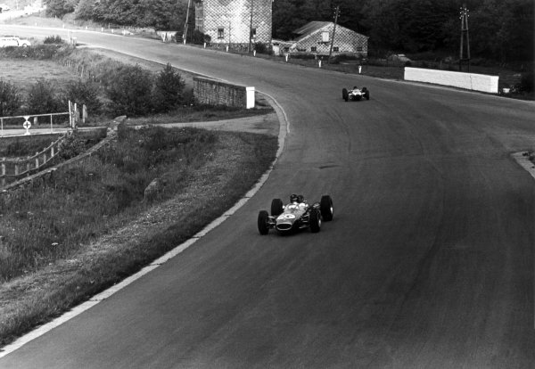 1965 Belgian Grand Prix.Spa-Francorchamps, Belgium. 11-13 June 1965.Dan Gurney, Brabham BT11, 10th position leads Lochen Rindt, Cooper T77, 11th position, at Stavelot. World Copyright - LAT Photographicref: 157A#32a