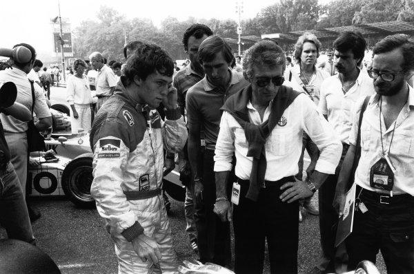 1982 Italian Grand Prix. Monza, Italy.10-12 September 1982. Andrea de Cesaris (Alfa Romeo 182), 10th position, talks with designer, Gerard Ducarouge, portrait.  World Copyright: LAT Photographic.  Ref:  B/W Print.