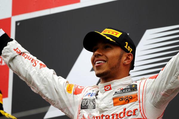 Nurburgring, Germany.24th July 2011Lewis Hamilton, McLaren MP4-26 Mercedes, 1st position, on the podium. Portrait. Podium. World Copyright: Andy Hone/LAT Photographicref: Digital Image CSP13412