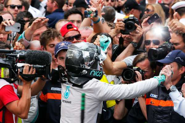 Monte Carlo, Monaco. Sunday 25 May 2014. Nico Rosberg, Mercedes AMG, 1st Position, celebrates in Parc Ferme, with his team. World Copyright: Steven Tee/LAT Photographic. ref: Digital Image _L4R7554