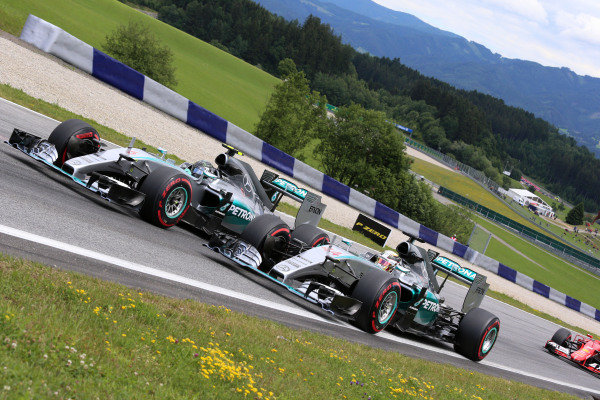 Nico Rosberg (GER) Mercedes AMG F1 W06 and Lewis Hamilton (GBR) Mercedes AMG F1 W06 at the start of the race at Formula One World Championship, Rd8, Austrian Grand Prix, Race, Spielberg, Austria, Sunday 21 June 2015. BEST IMAGE