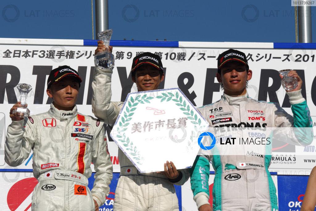 Round 9 & 10, Okayama, Japan. 25th August 2012.Rd 9 - Winner  Ryo Hirakawa ( #4 RSS ), 1st position.  2nd position Tomoki Nojiri ( #8 HFDP RACING ). 3rd position Yuichi Nakayama ( #36 PETRONAS TEAM TOM'S ), podium.World Copyright: Yasushi Ishihara/LAT Photographicref: Digital Image 2012JF3_Rd9&10_015