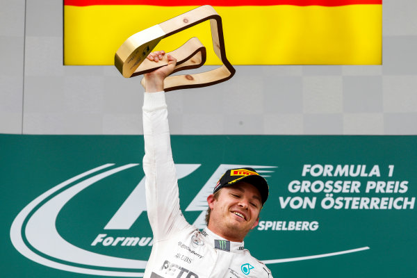 Red Bull Ring, Spielberg, Austria. Sunday 21 June 2015. Nico Rosberg, Mercedes AMG, 1st Position, celebrates on the podium. World Copyright: Glenn Dunbar/LAT Photographic. ref: Digital Image _89P5686