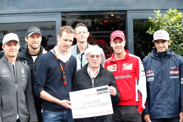 Monte Carlo, Monaco. Thursday 21 May 2015. Bernie Ecclestone, CEO and President, FOM, and the F1 drivers promote the Global Fan Survey. World Copyright: Alastair Staley/LAT Photographic. ref: Digital Image _R6T8489