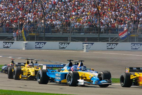 2002 American Grand Prix.Indianapolis, Indiana, USA. 27-29 September 2002.Jenson Button (Renault R202), Heinz-Harald Frentzen (Sauber C21 Petronas) and Takuma Sato (Jordan EJ12 Honda) at the start.World Copyright - LAT Photographicref: Digital File Only