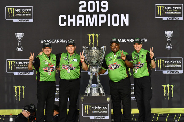#18: Kyle Busch, Joe Gibbs Racing, Toyota Camry M&M's, celebrates after winning 2019 Monster Energy Cup Series Championship. Interstate Batteries
