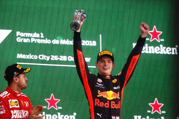 Winner Max Verstappen, Red Bull Racing, celebrates on the podium with Sebastian Vettel, Ferrari