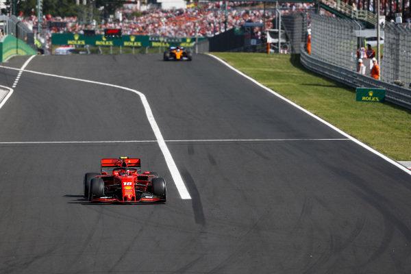 Charles Leclerc, Ferrari SF90, leads Carlos Sainz Jr., McLaren MCL34