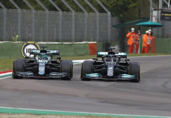 Sir Lewis Hamilton, Mercedes W12, battles with Lance Stroll, Aston Martin AMR21