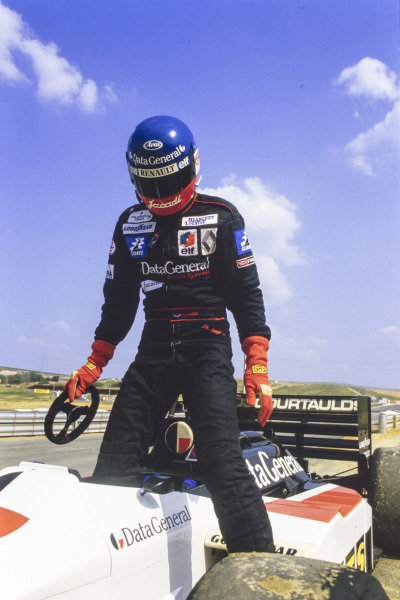 Philippe Streiff steps out of his Tyrrell 015 Renault.