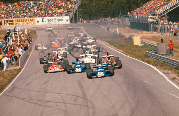 1974 Swedish Grand Prix.Anderstorp, Sweden.7-9 June 1974.Jody Scheckter leads teammate Patrick Depailler (both Tyrrell 007 Ford's), Ronnie Peterson (Lotus 72E Ford) and Niki Lauda (Ferrari 312B3) at the start. Ref-74 SWE 05.World Copyright - LAT Photographic