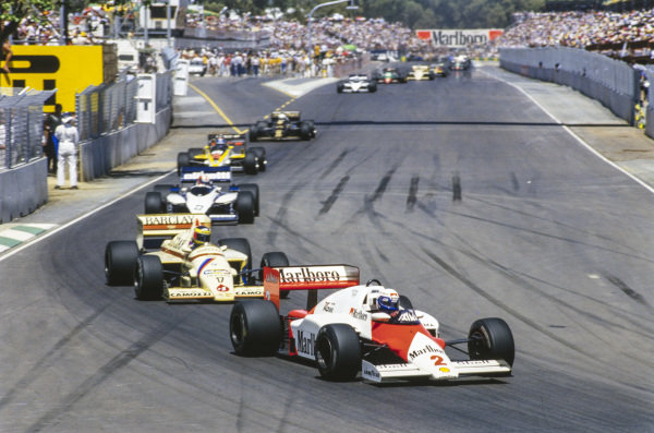 Alain Prost, McLaren MP4-2B TAG, leads Gerhard Berger, Arrows A8 BMW, Marc Surer, Brabham BT54 BMW, and Patrick Tambay, Renault RE60B.