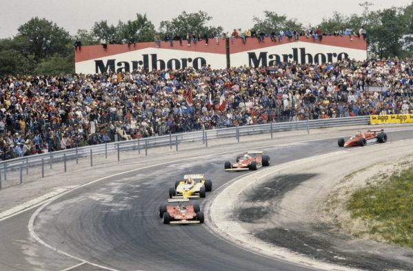 Gilles Villeneuve, Ferrari 312T4 leads Jean-Pierre Jabouille, Renault RS10, Jody Scheckter, Ferrari 312T4 and Nelson Piquet, Brabham BT48 Alfa Romeo.