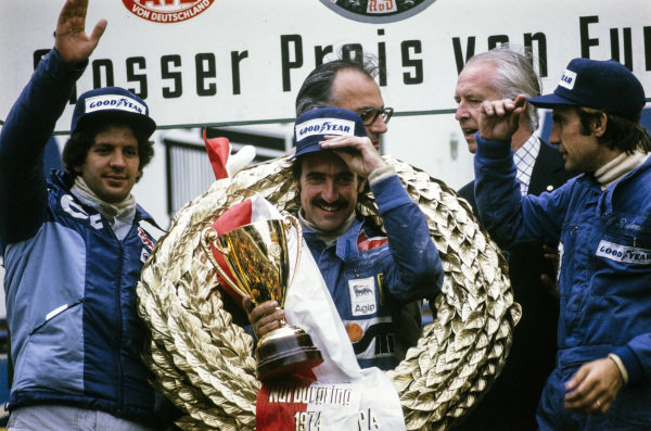 Clay Regazzoni celebrates victory on the podium with Jody Scheckter, 2nd position and Carlos Reutemann, 3rd position.