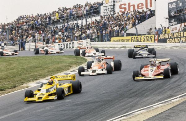 Jean-Pierre Jabouille, Renault RS01 leads Gilles Villeneuve, Ferrari 312T3 and James Hunt, McLaren M26 Ford.