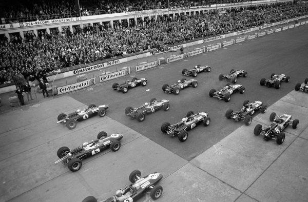 The field bunch up at the start of the race as they leave the grid.