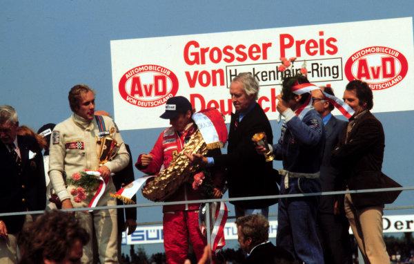 1977 German Grand Prix.Hockenheim, Germany.29-31 July 1977.(L-R) Hans-Joachim Stuck (Brabham Alfa Romeo) 3rd position, Niki Lauda (Ferrari) 1st position and Jody Scheckter (Wolf Ford) 2nd position on the podium.World Copyright - LAT Photographic