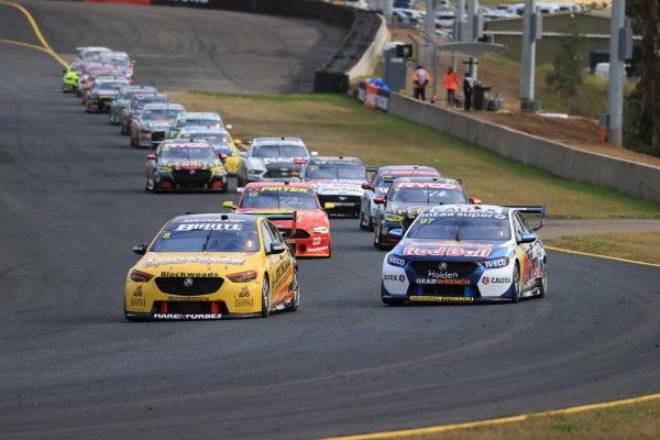 Nick Percat, Brad Jones Racing Holden, leads Shane van Gisbergen, Triple Eight Engineering Holden