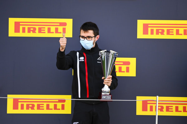 Winning Constructor celebrates on the podium with the trophy