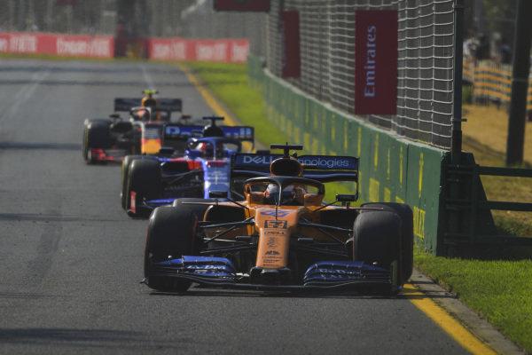 Carlos Sainz Jr., McLaren MCL34, leads Daniil Kvyat, Toro Rosso STR14, and Pierre Gasly, Red Bull Racing RB15