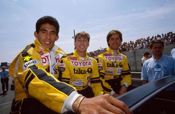 Aguri Suzuki (JPN), Johnny Dumfries (GBR), Roberto Ravaglia (ITA) TOM'S Toyota teammates during the driver's parade. Le Mans 24 Hours, Le Mans, France, 16 June 1990. BEST IMAGE