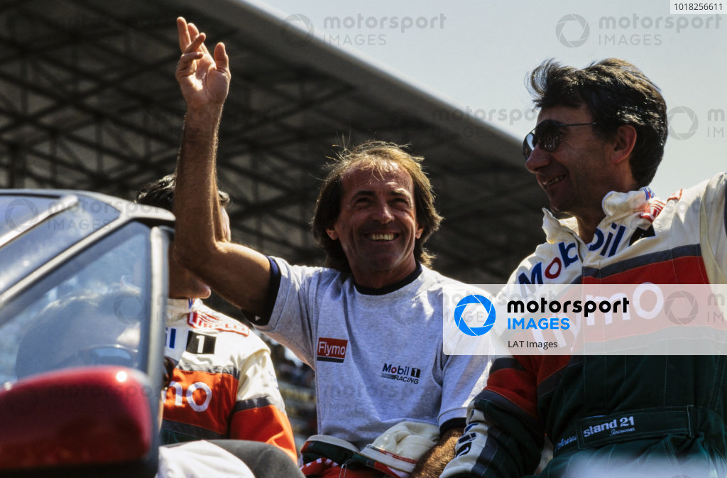 René Arnoux waves to the crowd on the drivers' parade between Justin Bell and Bertrand Balas.