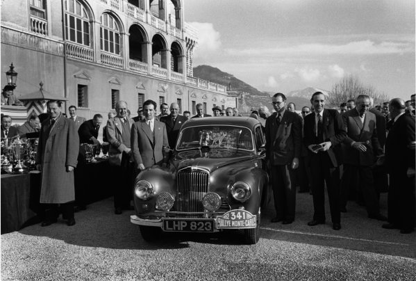 Monte Carlo, Monaco. 22nd January - 29th January 1952.Stirling Moss (Sunbeam- Talbot 90) with John Cooper (Autocar), 2nd position, outside the Palace to receive their medals, portrait.World Copyright: LAT Photographic.Ref: 4414G - 18.
