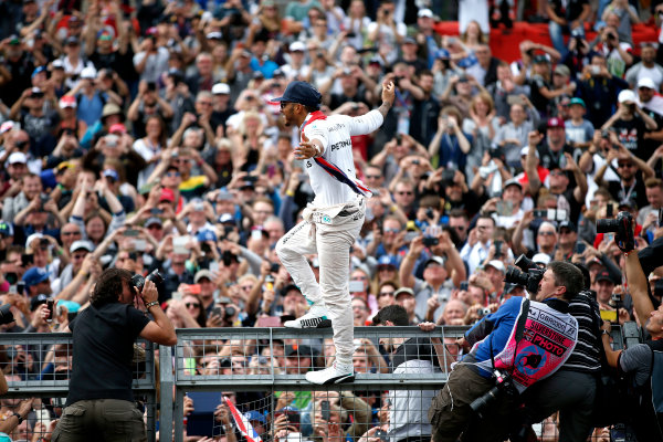 Silverstone, Northamptonshire, UK Sunday 10 July 2016. Lewis Hamilton, Mercedes AMG, 1st Position, celebrates victory at his home race with the fans. World Copyright: Dunbar/LAT Photographic ref: Digital Image _W2Q5477A