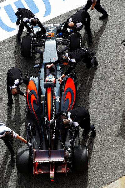 Circuit de Catalunya, Barcelona, Spain Monday 22 February 2016. Jenson Button, McLaren MP4-31 Honda, gets pushed back into the garage. World Copyright: Steven Tee/LAT Photographic ref: Digital Image _H7I0432
