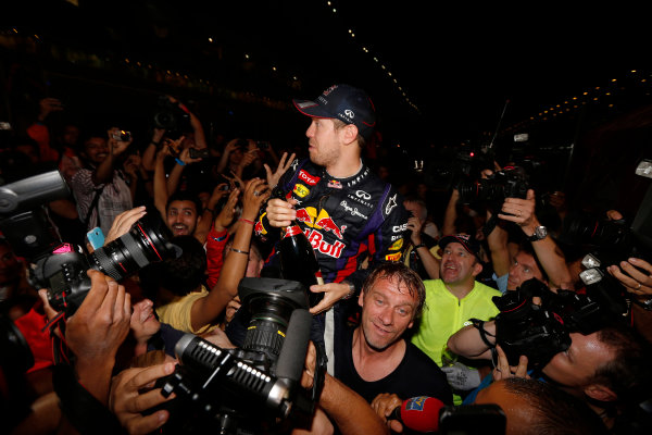 Buddh International Circuit, New Delhi, India. Sunday 27th October 2013. Sebastian Vettel, Red Bull Racing, 1st position, celebrates with fans after securing fourth drivers world title. World Copyright: Charles Coates/LAT Photographic. ref: Digital Image _N7T5932
