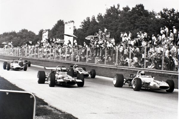 1969 Italian Grand Prix Monza, Italy. 7 September 1969 Jackie Stewart, Matra MS80-Ford, 1st position, leads Piers Courage, Brabham BT26-Ford, 5th position, Jo Siffert, Lotus 49B-Ford, 8th position, and Denny Hulme, McLaren M7C-Ford, 7th position, action World Copyright: LAT PhotographicRef: Motor b&w print