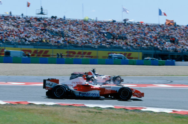 2005 French Grand Prix. Magny-Cours, France. 1st - 3rd July 2005 Takuma Sato, BAR Honda 007 slides wide after his attempt to pass Jarno Trulli, Toyota TF105. Action. World Copyright: Steven Tee/LAT Photographi--c Ref: 35mm Image A13