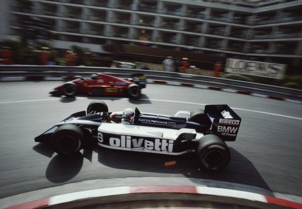 Elio de Angelis, Brabham BT55 BMW, passes Stefan Johansson, Ferrari F1/86, at Loews hairpin during practice.