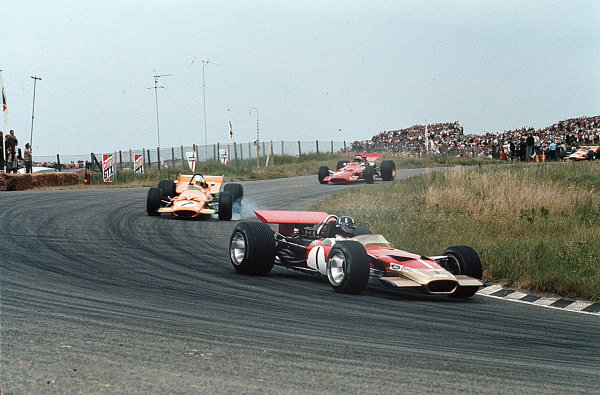 Zandvoort, Holland.19-21 June 1969.Graham Hill (Lotus 49B Ford) leads Denny Hulme (McLaren M7A Ford) and Chris Amon (Ferrari 312). They finished in 7th, 4th and 3rd positions respectively.Ref-35mm 69 HOL 23.World Copyright - LAT Photographic