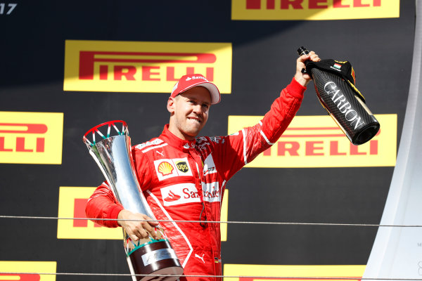 Hungaroring, Budapest, Hungary.  Sunday 30 July 2017. Sebastian Vettel, Ferrari, 1st Position, with his trophy. World Copyright: Glenn Dunbar/LAT Images  ref: Digital Image _X4I2931